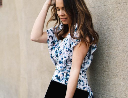 Anneli wearing Reiss Dress standing by wall
